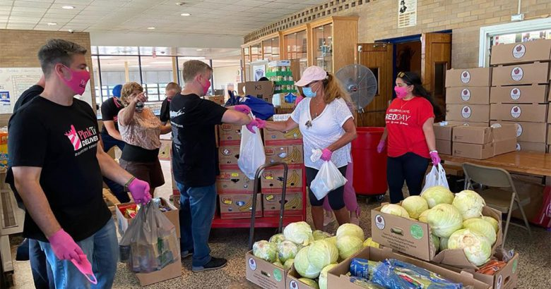 Pink Tie marks a year of food deliveries to local pantries